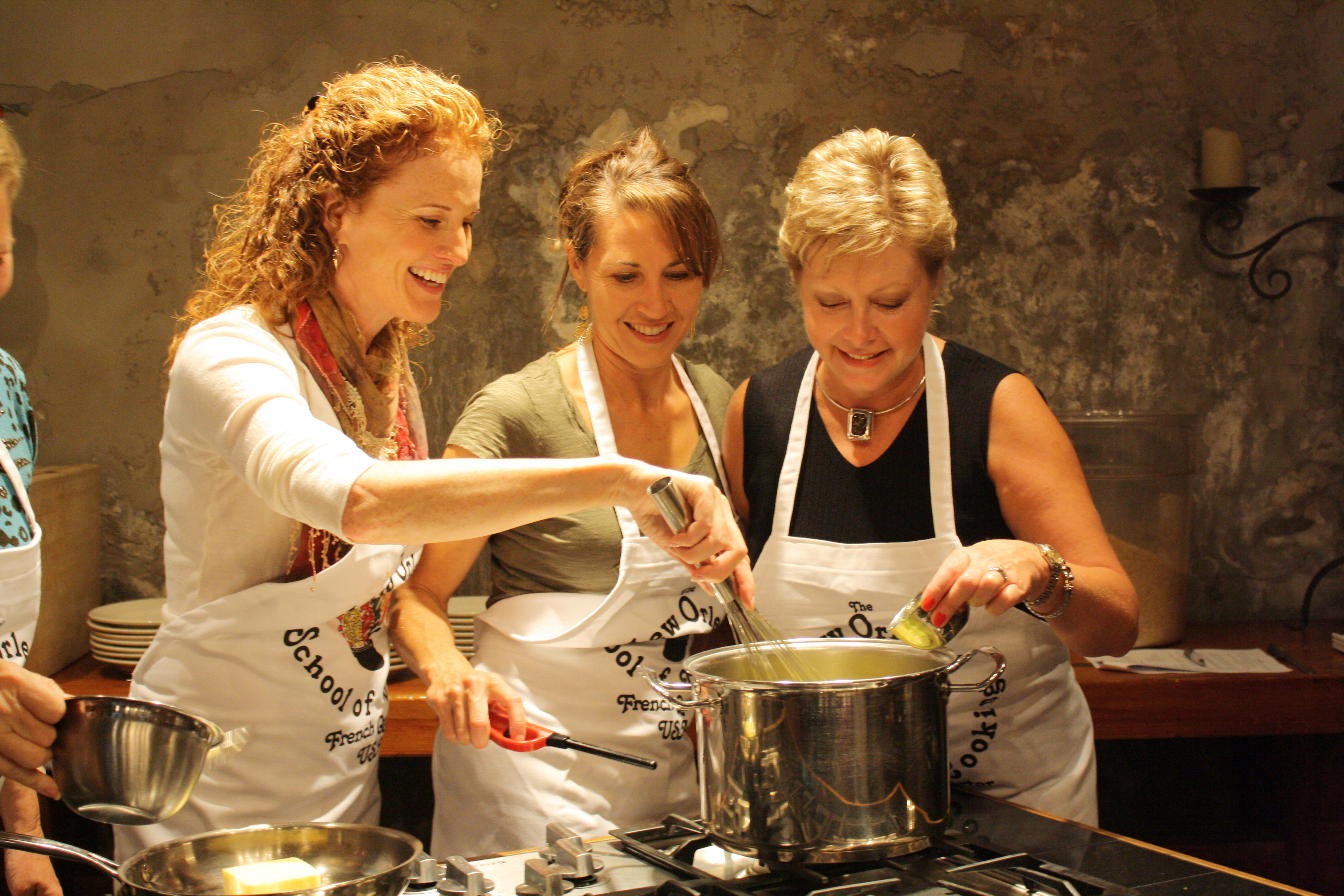 three women cooking holiday tradition